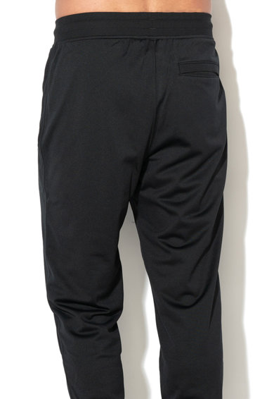 Under Armour Спортен панталон Sportstyle със свободна кройка Мъже