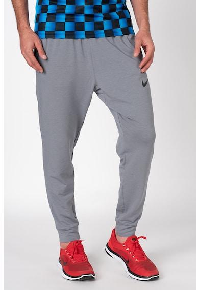 Nike Dri-FIT szűkülő szárú edzőnadrág megkötővel a derékrészen férfi