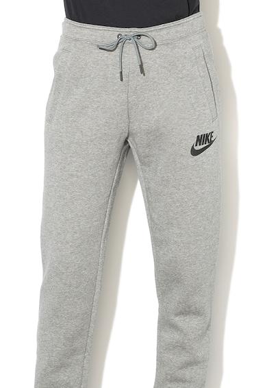 Nike Pantaloni sport cu captuseala din fleece si buzunare oblice Femei