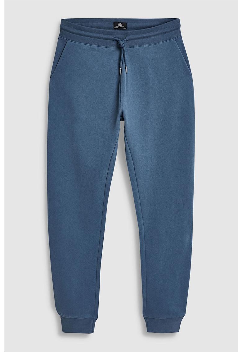Pantaloni sport cu terminatii elastice