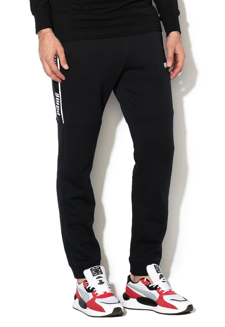 Pantaloni cu banda logo laterala - pentru fitness Amplified de la Puma