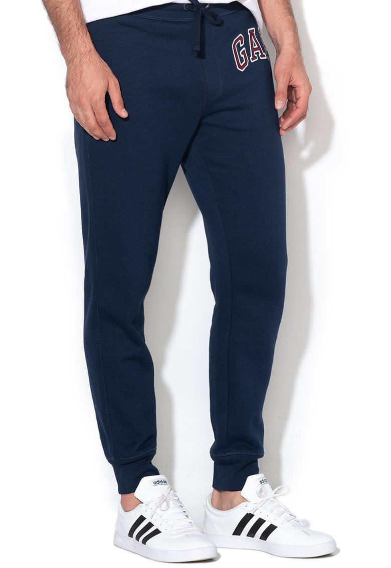 Pantaloni sport cu captuseala din material fleece si broderie logo imagine fashiondays.ro