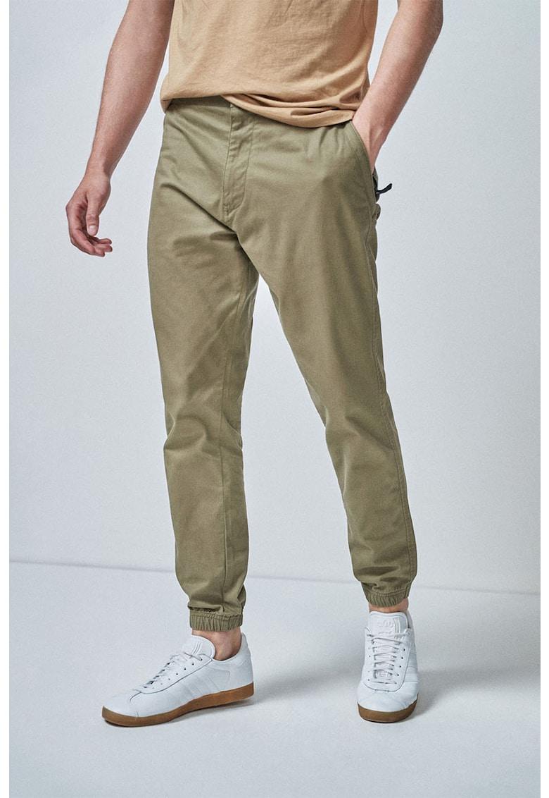 Pantaloni slim-fit cu banda elastica in talie de la NEXT