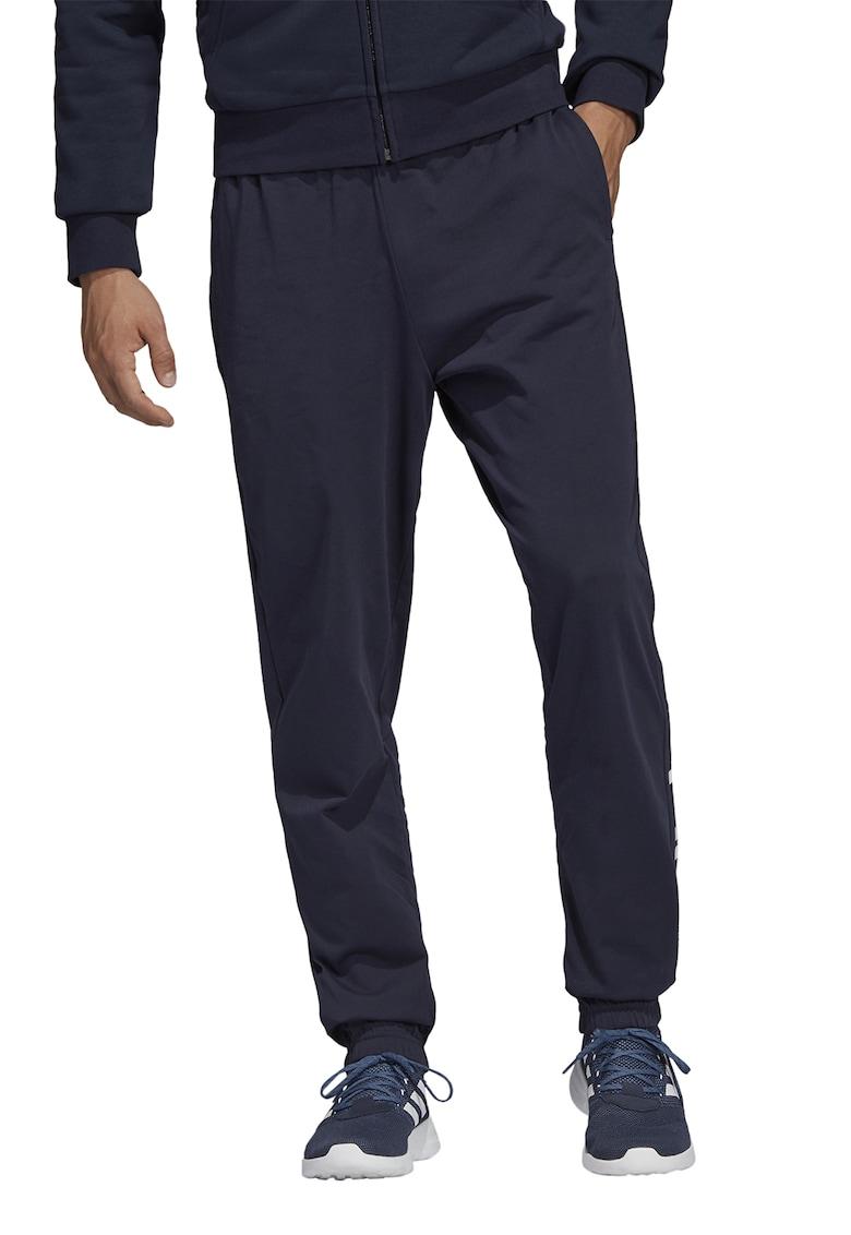 Pantaloni sport cu croiala conica si imprimeu logo imagine