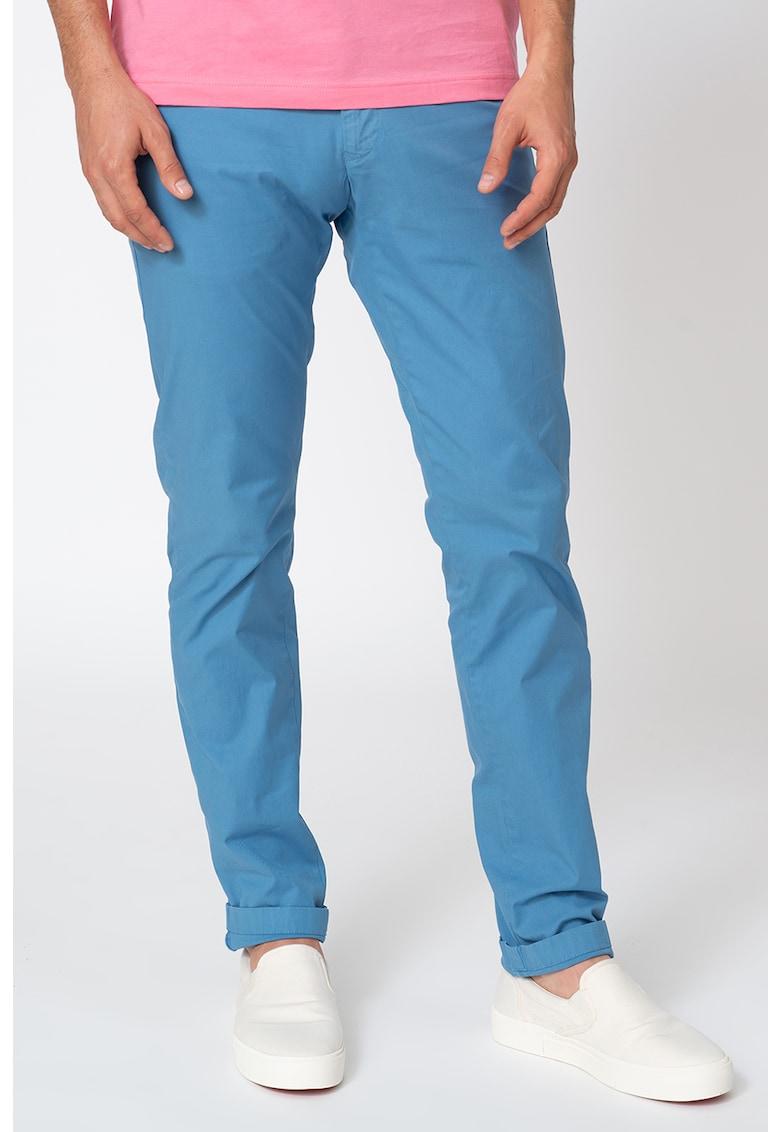 Pantaloni cu croiala conica si buzunare oblice