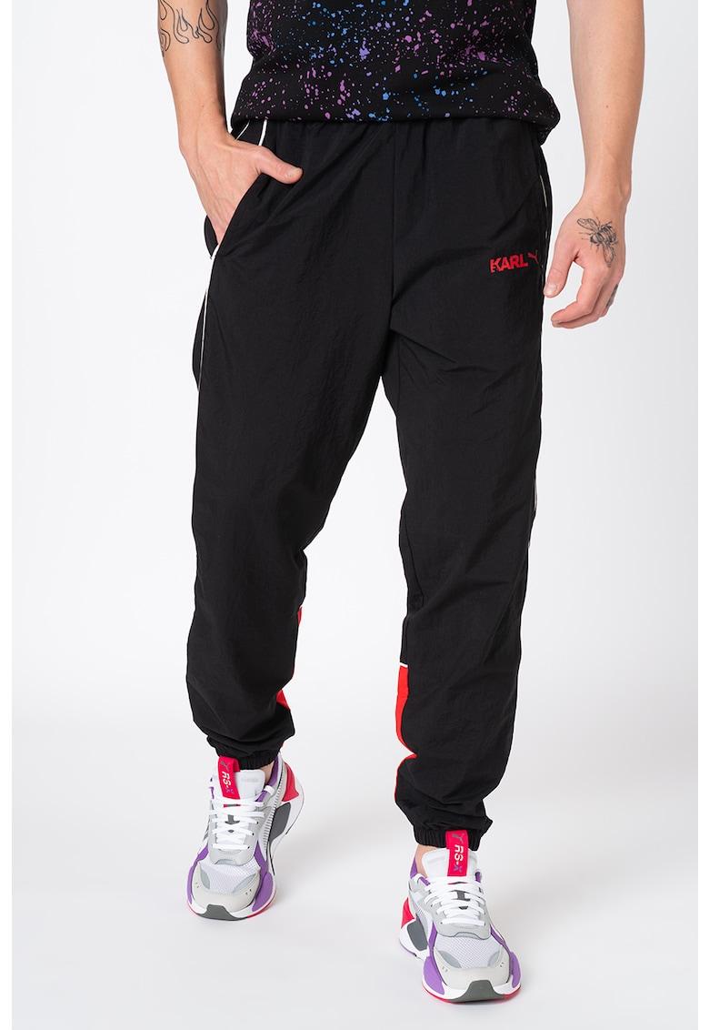Pantaloni conici - cu logo - pentru alergare de la Puma