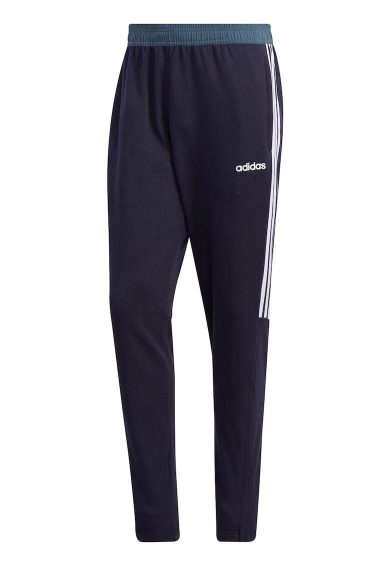 Pantaloni sport conici cu dungi emblematice