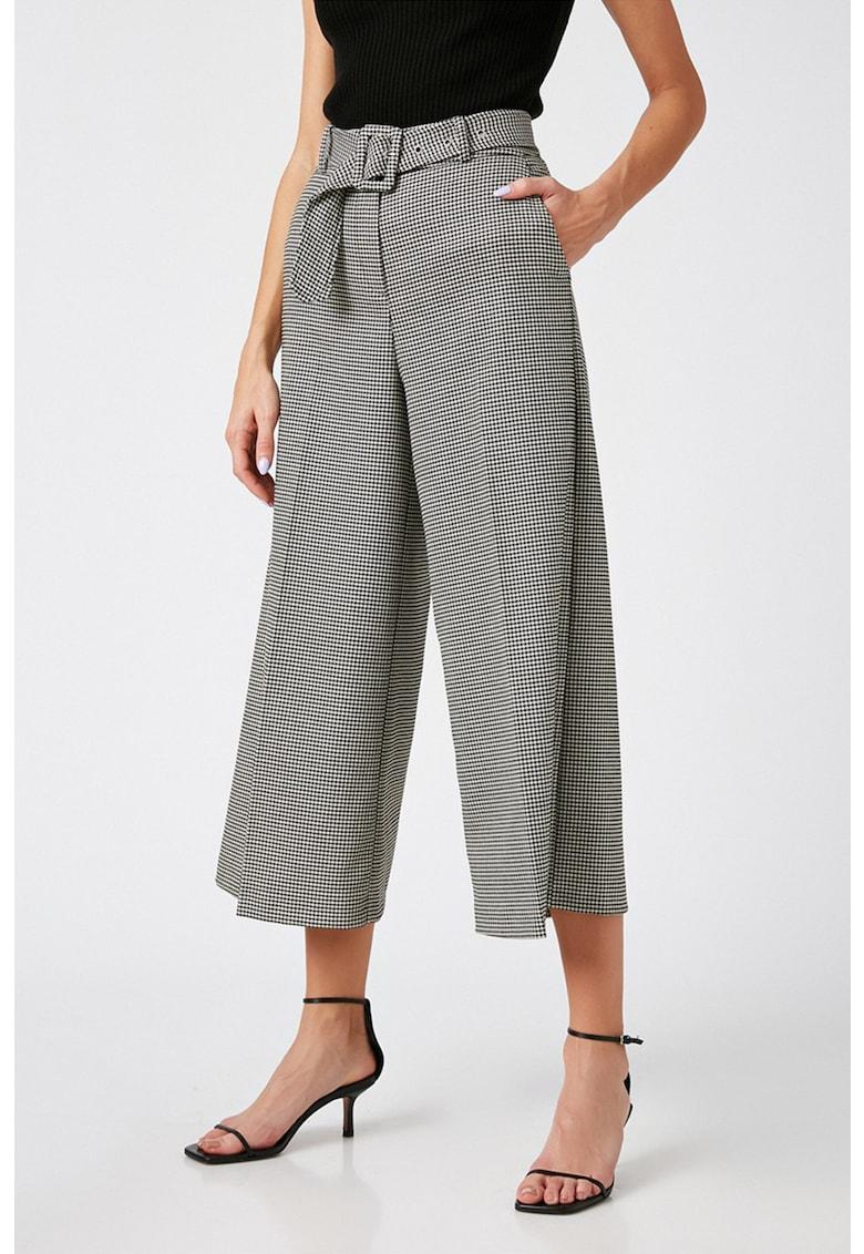 Pantaloni capri cu croiala ampla si model houndstooth