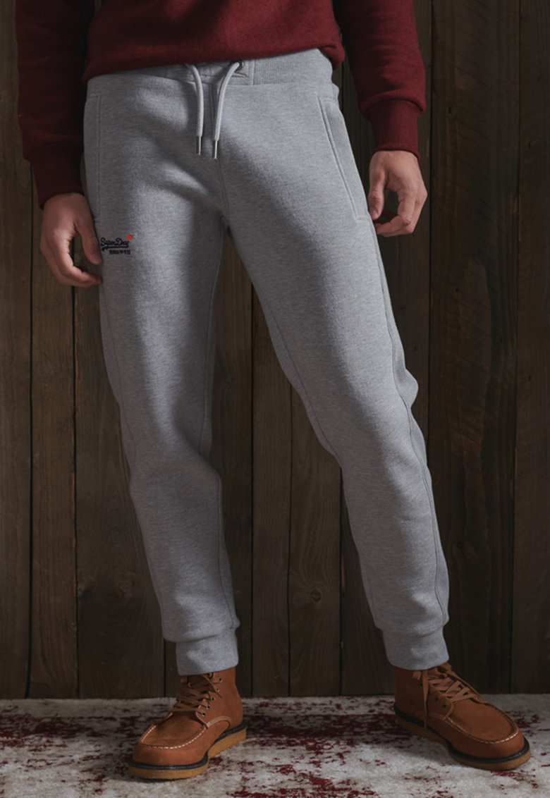 Pantaloni sport cu broderie logo discreta