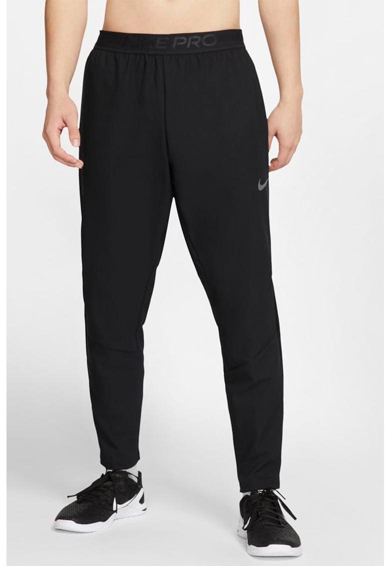 Pantaloni conici pentru fitness Nike fashiondays.ro