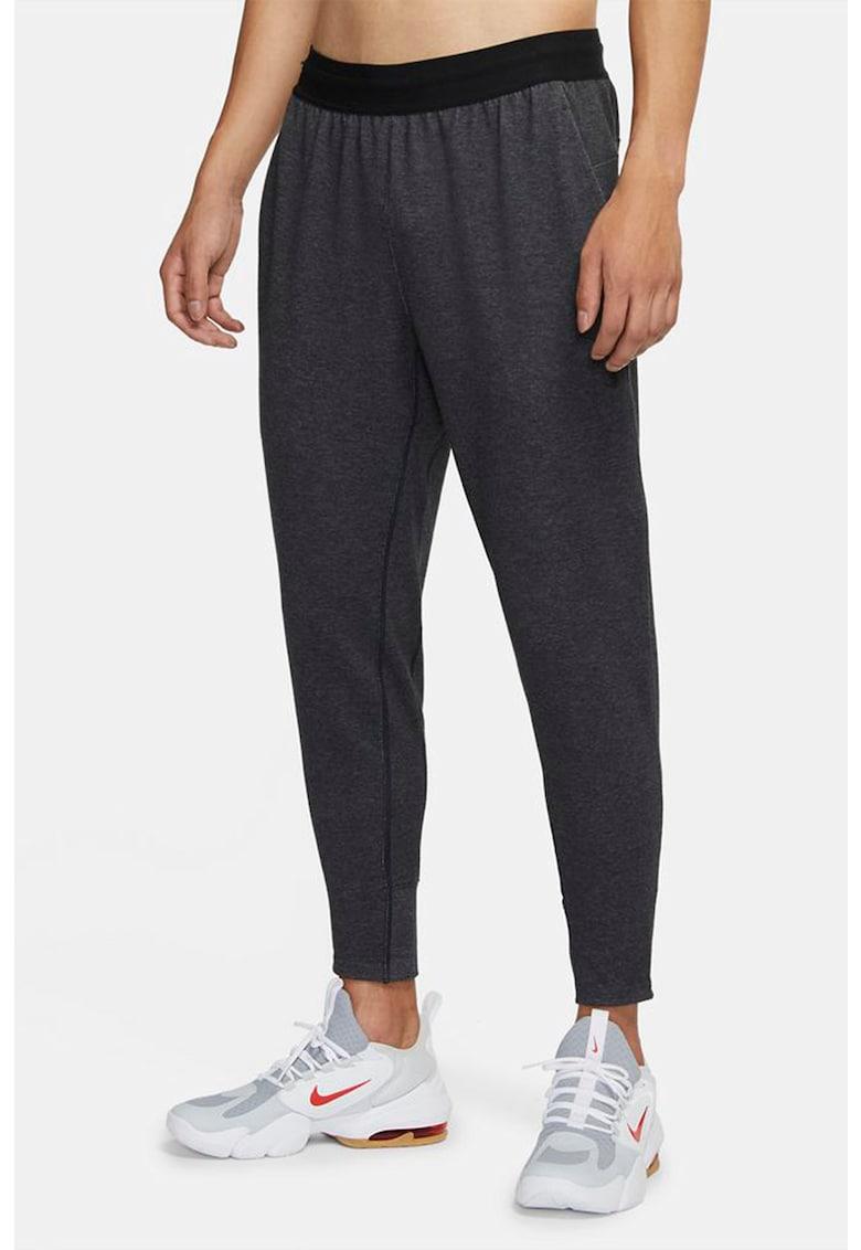 Pantaloni relaxed fit cu snur de ajustare pentru yoga Nike fashiondays.ro