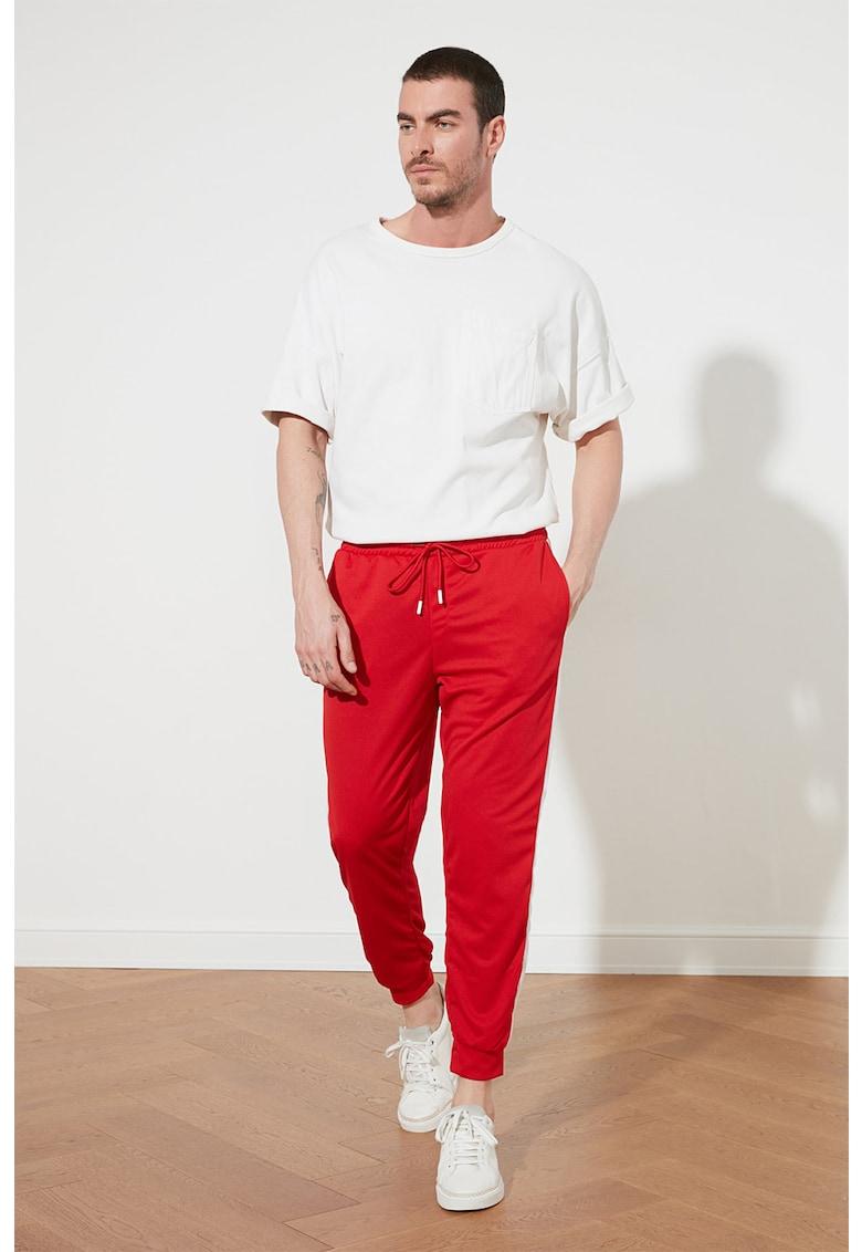 Pantaloni sport conici cu benzi laterale contrastante imagine fashiondays.ro