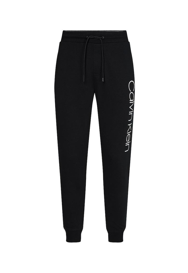 Pantaloni sport conici cu imprimeu logo