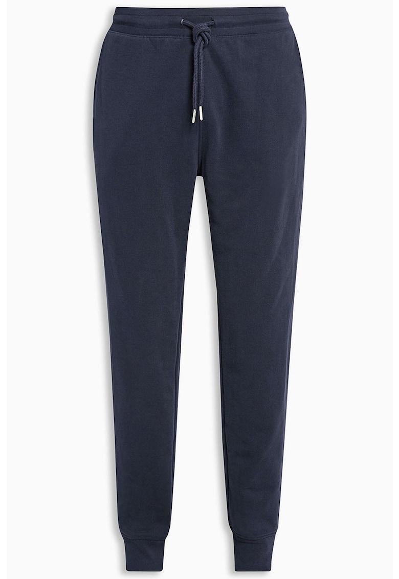 Pantaloni sport cu buzunar pe partea din spate